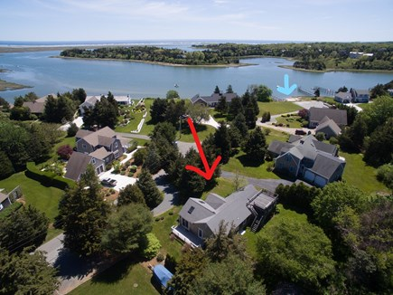 Eastham Cape Cod vacation rental - aerial showing the duplex (red arrow) and beach (blue arrow)