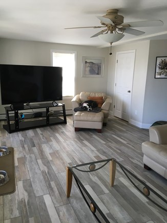 West Yarmouth Cape Cod vacation rental - Living room w/ 12 ft slider to deck with distant waterview