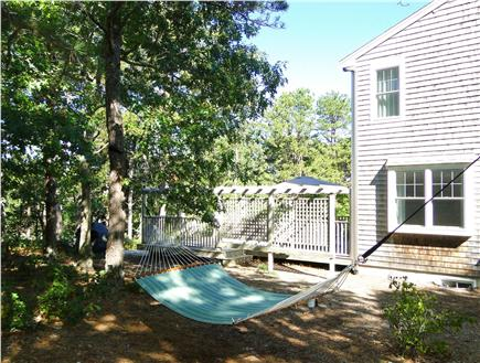 Wellfleet Cape Cod vacation rental - Relax in hammock, showing deck in background
