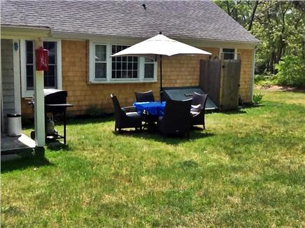 South Yarmouth Cape Cod vacation rental - Large backyard with grill, patio set, hammocks & outdoor shower.