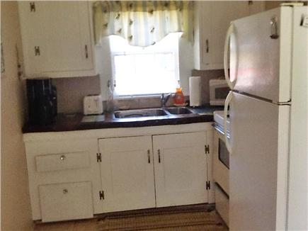 South Yarmouth Cape Cod vacation rental - View of kitchen with new stove and reading nook in kitchen window