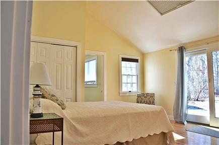 South Yarmouth Cape Cod vacation rental - Master - high ceilings and slider to deck