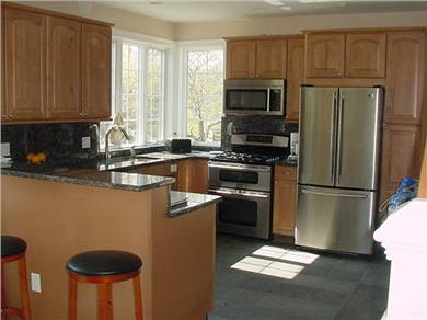 Eastham Cape Cod vacation rental - Modern kitchen w/stainless appliances and a breakfast bar