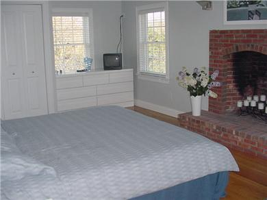 Eastham Cape Cod vacation rental - Large master bedroom w/ 18' ceillings, king size bed, and cot
