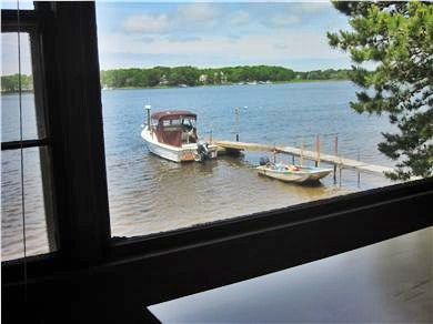 Mashpee Cape Cod vacation rental - View of the dock while sitting at the dining table.