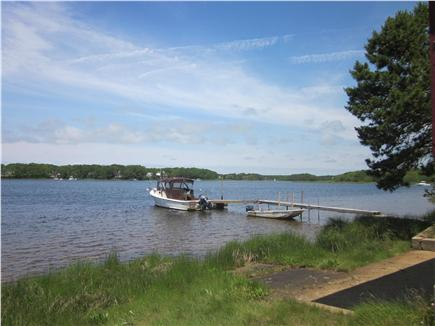 Mashpee Cape Cod vacation rental - The dock with our boats tied up on salt water Jehu Pond.