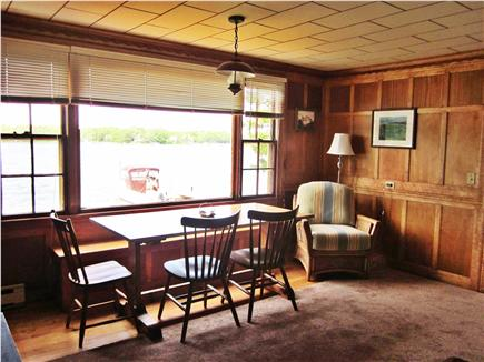 Mashpee Cape Cod vacation rental - The dining table in front of picture window looking at Jehu Pond.