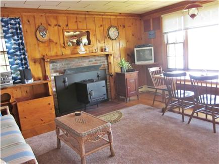 Mashpee Cape Cod vacation rental - The dining/living area with the wood stove for cold weather.