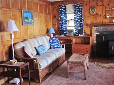Mashpee Cape Cod vacation rental - The sofa in front of the birds eye paneling.