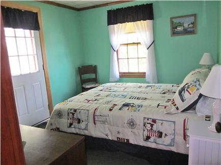 Mashpee Cape Cod vacation rental - Master bedroom with queen bed and view over the marsh.