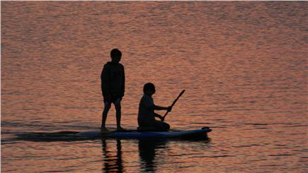South Dennis Cape Cod vacation rental - Kids paddle boarding at sunset. Bring your kayaks or SUPs!