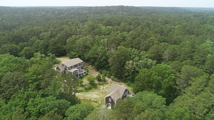 Wellfleet Cape Cod vacation rental - Aerial view from back showing decks on both main house and barn