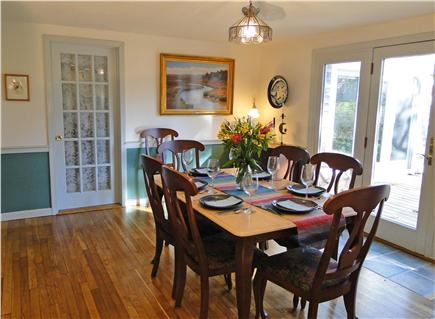 Chatham Cape Cod vacation rental - Spacious dining room with slider to deck and door toward entrance