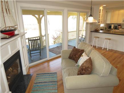 West Barnstable Cape Cod vacation rental - Carriage house living room with deck and kitchen beyond