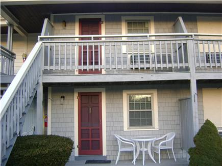 West Dennis Cape Cod vacation rental - First floor patio entry. Second floor balcony with pool view.