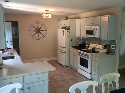 West Harwich Cape Cod vacation rental - Kitchen Area, back door entrance & basement staircase