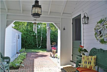 Harwichport, near Bank Street  Cape Cod vacation rental - Relaxing breezeway and entrance to private backyard gardens