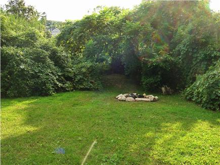 Sandwich Cape Cod vacation rental - Sunny and private backyard with fire pit