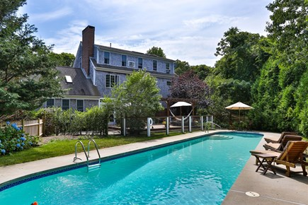 Orleans Cape Cod vacation rental - A view of the 3 story house looking from the deep end of the pool