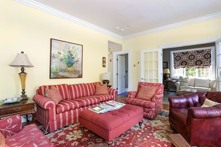 Orleans Cape Cod vacation rental - Warm, cozy, colorful seating area in  high ceilinged living room