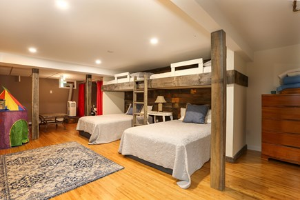 Orleans Cape Cod vacation rental - The rumpus room down cellar sleeps 6 and has a smart TV + a stage