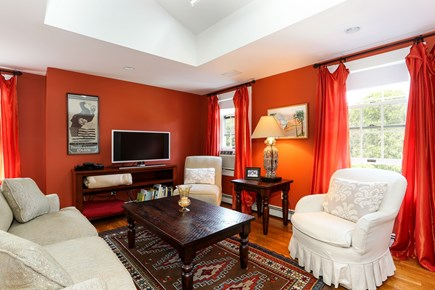 Orleans Cape Cod vacation rental - The seating area with TV in the orange BR on the 3rd floor.