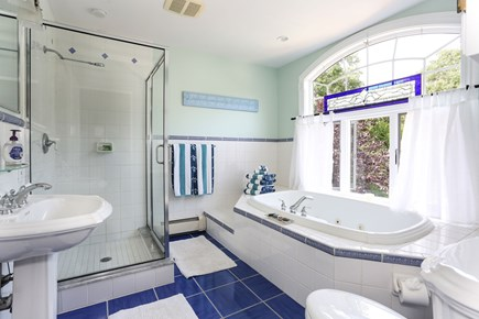 Orleans Cape Cod vacation rental - The big blue bathroom adjoins the fireplaced bedroom on 2nd floor
