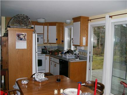 Eastham Cape Cod vacation rental - Dining area & kitchen with sliders to deck