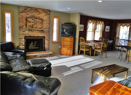 Truro Cape Cod vacation rental - Spacious living room with fireplace and TV
