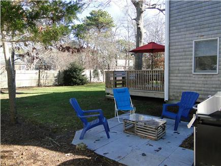 West Yarmouth Cape Cod vacation rental - Patio area with grill and seating, at side of house