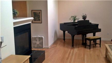 Wellfleet Cape Cod vacation rental - First floor fireplace and piano in living room