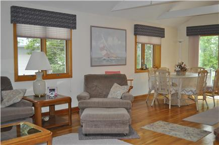 Mashpee Cape Cod vacation rental - Family room opens to dining area and sliding door to deck