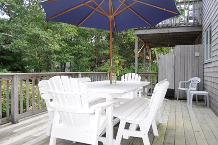 Mashpee Cape Cod vacation rental - Large back deck with outdoor shower; new table seats 8-10