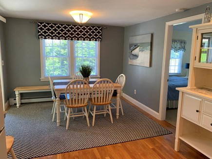 Dennis Cape Cod vacation rental - Dining table seats 8, near slider to family room