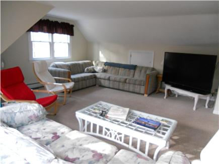 Eastham, Massachusetts Cape Cod vacation rental - Great Room with sleeper sofa, large screen TV and DVD player.