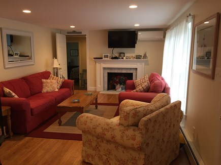 West Dennis Cape Cod vacation rental - Main living room (door to the other side is left of fireplace)