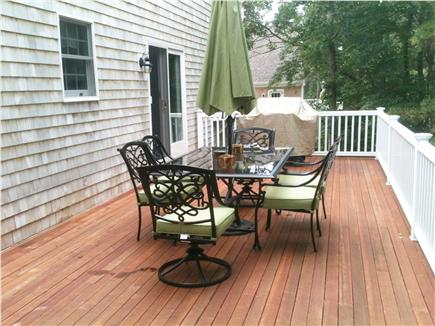 Mashpee Cape Cod vacation rental - Deck with gas grill and dining table that seats 6