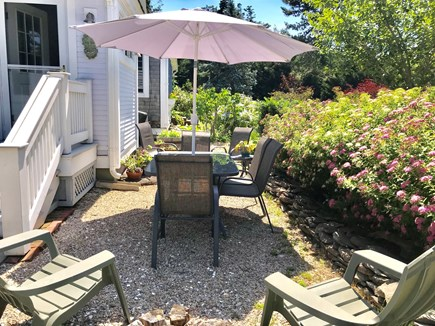 Nauset Heights (East Orleans) Cape Cod vacation rental - Patio off side entry. Privacy hedge. Lounging. Meals. 2 Webers.