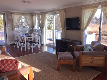 Orleans Cape Cod vacation rental - Another look at living area toward dining and out to deck