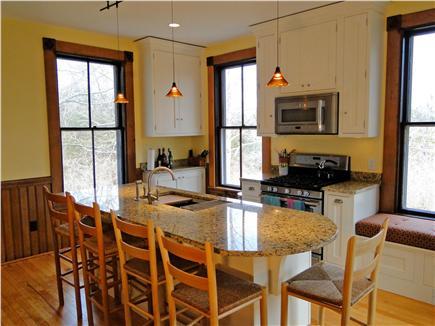 East Dennis Cape Cod vacation rental - Kitchen includes breakfast bar & overlooks large backyard & marsh