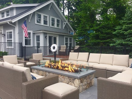Orleans Cape Cod vacation rental - Carriage House overlooking gas fire table and pool patio.