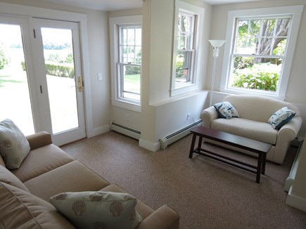 Orleans Cape Cod vacation rental - Carriage House lounge area overlooking pool, grounds and cove.