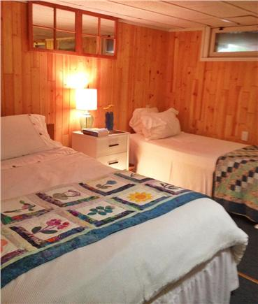 Hyannis Cape Cod vacation rental - Downstairs bedroom with a full sized bed and a twin.