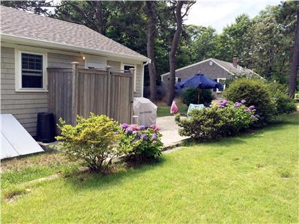 Dennis, Beach Street @ Mayflower beach Cape Cod vacation rental - Outside shower,patio, grill/table for dining. Spacious backyard