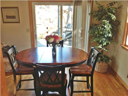 Harwich Cape Cod vacation rental - Dining room from kitchen, out slider to deck