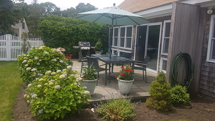 West Harwich Cape Cod vacation rental - Patio with dining area and gas grill