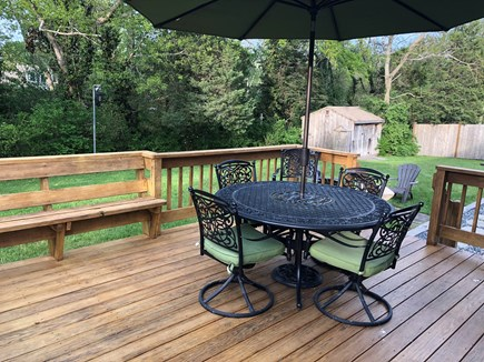 Dennis Cape Cod vacation rental - Newly stained Outdoor deck with plenty of seating, and gas grill