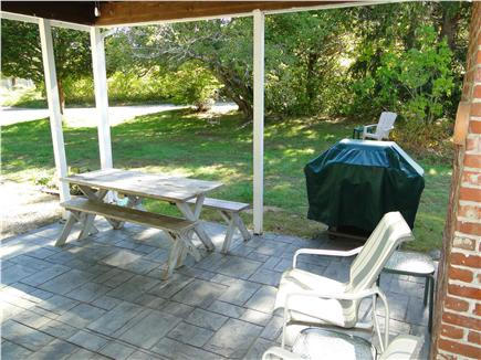 Brewster Cape Cod vacation rental - A favorite place to sit – covered patio area