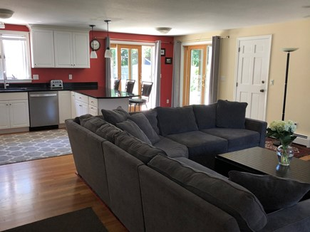 Centerville Cape Cod vacation rental - Open plan kitchen/family area with sliders to deck & grill.