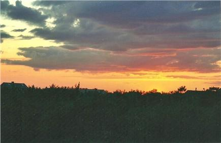 North Truro Cape Cod vacation rental - Sunset from the deck overlooking P'town & Long Point